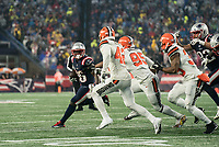 FOXBOROUGH, MA - OCTOBER 27: New England Patriots Runningback Sony Michel #26 breaks right after a short pass with Cleveland Browns Safety Morgan Burnett #42, Cleveland Browns Defensive End Myles Garrett #95 and Cleveland Browns Safety Jermaine Whitehead #35 in pursuit during a game between Cleveland Browns and New Enlgand Patriots at Gillettes on October 27, 2019 in Foxborough, Massachusetts.