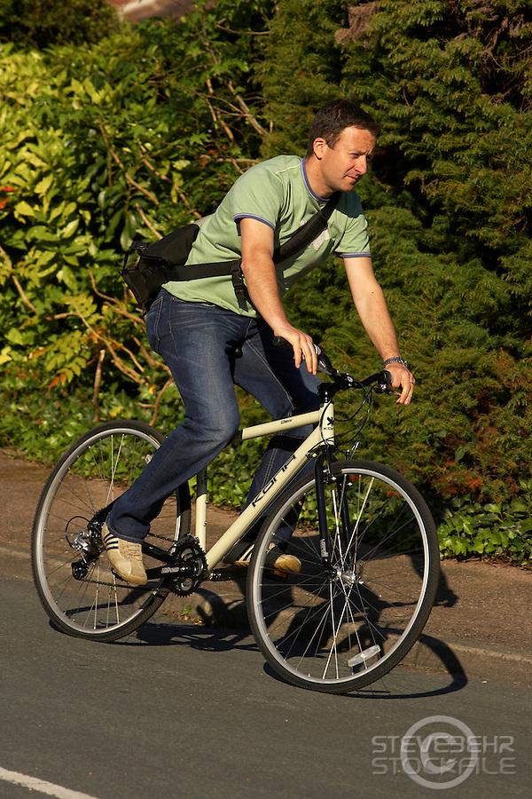 Graham riding kona commuting bike , Sunningdale , Berks , May 2005.pic copyright Steve Behr / Stockfile
