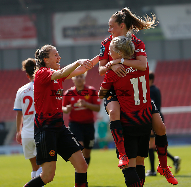 Leah Galton of Manchester United Women cele with Ella Toone of Manchester United Women and Lizzie Arnot of Manchester United Women