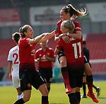 Leah Galton of Manchester United Women cele with Ella Toone of Manchester United Women and Lizzie Arnot of Manchester United Women
