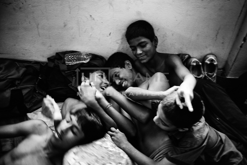 Young boxers having fun  inside of the Mohammad Ali Boxing stadium dormitory. Dhaka, Bangladesh