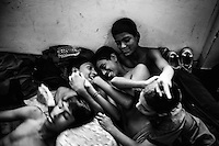 Young boxers having fun  inside of the Mohammad Ali Boxing stadium dormitory. Dhaka, Bangladesh