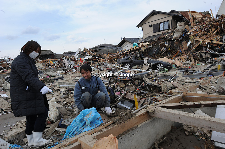 Osamu Watanabe and his wife search through the floor-boards, all that remanis of their coastal home in the town of Natori. The Watanabes described the wave coming from three directions into the village and flattening most of the houses. The Watanabes came back hoping to find their family shrine that represented their parents an grand-parents, all they found was an urn that housed Osamu's father's ashes and a screw-driver. Earthquake in Japan on 11 Mar 2011 had killed thousands of people. The death toll was expected to rise dramatically, with tens of thousands reported missing..14 Mar 2011