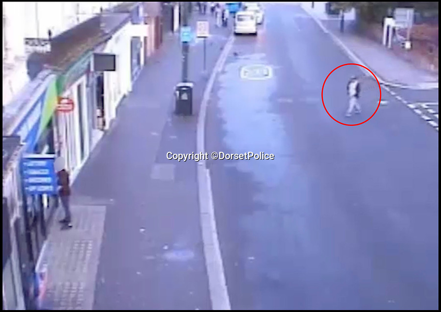 BNPS.co.uk (01202 558833)Pic: DorsetPolice/BNPS<br /> <br /> A screenshot of CCTV footage showing Kevin Boyle following Glen Morrant at around 6:25am on Friday 18th August 2017.<br /> <br /> Boyle mistakes Glen Morrant as one of the bystanders 2 hours earlier on in the evening.<br /> <br /> Circled in red is Kevin Boyle.<br /> <br /> A knife maniac who nearly killed an innocent bystander he mistook for someone he had a row with because both men had ginger hair was today jailed for 21 years.<br /> <br /> Kevin Boyle waited outside a Bournemouth nightclub for the red-headed reveller who had shoved him two hours earlier to appear.<br /> <br /> When clubber Glen Morrant walked out Boyle began to follow him by mistake because he was wearing similar clothes to the first man and also had ginger hair.<br /> <br /> Boyle slashed the 19-year-old by the throat. He was sentenced today at Winchester Crown Court.