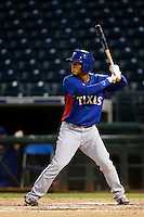 Diego Cedeno #9 of the AZL Rangers bats against the AZL Royals at Surprise Stadium on July 15, 2013 in Surprise, Arizona. AZL Rangers defeated the AZL Royals, 3-2. (Larry Goren/Four Seam Images)