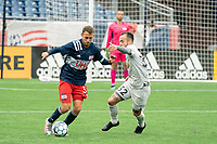 FOXBOROUGH, MA - APRIL 17: Emiliano Terzaghi #32 of Richmond Kickers pressures Jake Rozhansky #32 of New England Revolution II during a game between Richmond Kickers and Revolution II at Gillette Stadium on April 17, 2021 in Foxborough, Massachusetts.