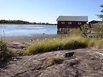 Rocky Harbor Boathouse on the Island of Kökar, Åland, Finland