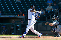Surprise Saguaros designated hitter Vladimir Guerrero Jr. (27), of the Toronto Blue Jays organization, follows through on his swing during an Arizona Fall League game against the Peoria Javelinas at Surprise Stadium on October 17, 2018 in Surprise, Arizona. (Zachary Lucy/Four Seam Images)