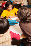 Education elementary Grade 3 science activity small groups of children using balance scales