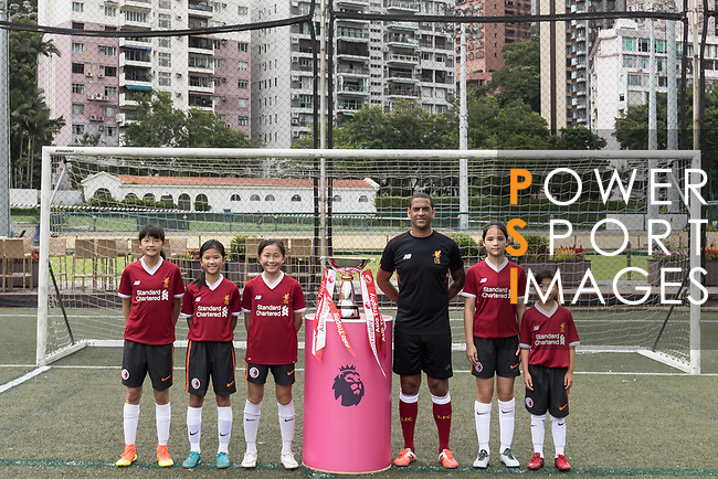 Phil Babb and Hong Kong children pose for a group photo with the Premier League Asia Trophy in front of the Hong Kong skyline for the launch of the Premier League Asia Trophy 2017 at the Hong Kong Football Club on 01 June 2017 in Hong Kong, China. Photo by Chris Wong / Power Sport Images