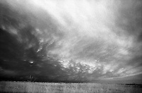 Storm clouds in infrared near Lubbock, Texas.<br /> <br /> Nikon F3HP, 24mm lens, Kodak High-Speed Infrared film, red filter
