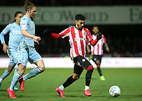 Said Benrahma of Brentford in action as Luke Ayling of Leeds United looks on during Brentford vs Leeds United, Sky Bet EFL Championship Football at Griffin Park on 11th February 2020