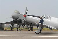 "-  FIAT G 46 training airplane (1950) taxiing in front of a Eurofighter ""Typhoon"" fighter aircraft ....- aereo da addestramento FIAT G 46 (1950) in rullaggio davanti ad un caccia Eurofighter ""Typhoon"""