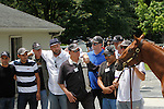 June 8, 2012. The announcement is made on June 8, 2012 that I'll Have Another is scratched from the Belmont Stakes at Belmont Park in Elmont, New York, thus ending his chances to be the first Triple Crown winner since Affirmed in 1978. Members of Team O'Neill, including trainer Doug O'Neill (white shirt, beard, hat with brim) join the horse for a press conference outside the stakes barn. Belmont Park Race Track, Elmont, NY. ©Joan Fairman Kanes/Eclipsesportswire