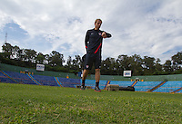 United States Men's National Coach Jurgen Klinsmann looks at his watch while inspecting the pitch at Estadio Mateo Flores in Guatemala City, Guatemala before his team's practice on Mon. June 11, 2012.