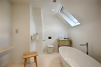 BNPS.co.uk (01202 558833)<br /> Pic: Mullucks/BNPS<br /> <br /> New bathroom.<br /> <br /> A retired couple dubbed 'the accidental upsizers' have put their luxury home on the market for a whopping £750,000.<br /> <br /> Jean and Desmond Lawton bought a suburban bungalow three years ago as they looked to downsize from a large property.<br /> <br /> But they soon decided that they didn't like the dated decour of the humble home and transformed it beyond recognition.<br /> <br /> They knocked down every internal retaining wall bar one to create an open-plan space and built a single-storey extension to the rear.