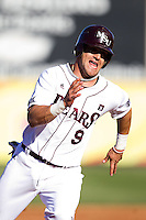 Spiker Helms (9) of the Missouri State Bears rounds third base during a game against the Southern Illinois University- Edwardsville Cougars at Hammons Field on March 10, 2012 in Springfield, Missouri. (David Welker / Four Seam Images)