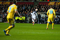 Swansea, UK. Thursday 20 February 2014<br /> Pictured: Jonathan de Guzman crosses the ball in for the Swans<br /> Re: UEFA Europa League, Swansea City FC v SSC Napoli at the Liberty Stadium, south Wales, UK