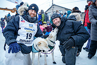 Gunnar Johnson poses at the finish line with his lead dogs Delta and Queen along with the dog's owner, Iditarod musher Jim Lanier in Nome  during the 2017 Iditarod on Friday March 17, 2017.<br /> <br /> Photo by Jeff Schultz/SchultzPhoto.com  (C) 2017  ALL RIGHTS RESERVED