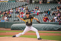 Drew Rucinski (22) starting pitcher of the Salt Lake Bees delivers a pitch to the plate against the Oklahoma City Dodgers in Pacific Coast League action at Smith's Ballpark on May 27, 2015 in Salt Lake City, Utah.  (Stephen Smith/Four Seam Images)