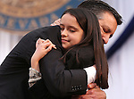 Gov. Brian Sandoval hugs his daughter Marisa, 10, after taking the oath of office on the steps of the Capitol, in Carson City, Nev., on Monday, Jan. 5, 2015. (Las Vegas Review-Journal/Cathleen Allison)