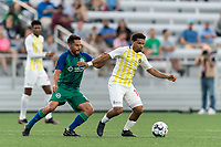 HARTFORD, CT - AUGUST 17: Zeiko Lewis #10 of Charleston Battery dribbles as Danny Barrera #10 of Hartford Athletic pressures during a game between Charleston Battery and Hartford Athletic at Dillon Stadium on August 17, 2021 in Hartford, Connecticut.