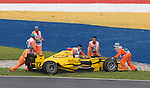 05 Apr 2009, Kuala Lumpur, Malaysia ---    Marshalls pull out the car of DPR driver Giacomo Ricci of Italy during the race 2 of the FIA GP2 Asia Series 2009 at the Sepang circuit, near Kuala Lumpur. Photo by Victor Fraile --- Image by © Victor Fraile / The Power of Sport Images