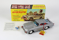 """BNPS.co.uk (01202 558833)<br /> Pic: BNPS<br /> <br /> Pictured: A battery operated James Bond Aston Martin DB5 as seen in 'Goldfinger' and 'Thunderball', 1965.<br /> <br /> An exact replica of the secret weapons case used by Sean Connery's 007 in From Russia With Love has emerged for sale for £14,000. <br /> <br /> The black attache case is one of only 100 models ever produced and has been described by experts as the """"holy grail"""" of James Bond memorabilia. <br /> <br /> The replica is to be sold alongside dozens of sought-after Bond items, including a set of 21 hand painted Corgi model figures, at Ewbank's Auctions of Woking, Surrey."""