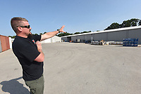 Guy Joubert with Wilson Combat gun makers shows Wednesday July 14 2021 the outside of a major expansion at the company south of Berryville.<br />(NWA Democrat-Gazette/Flip Putthoff)