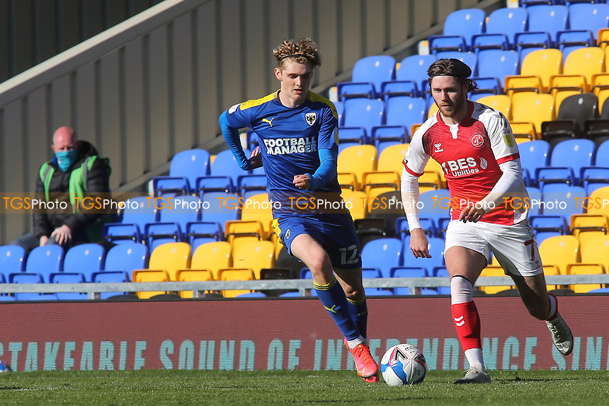 Wes Burns of Fleetwood Town in possession as AFC Wimbledon's Jack Rudoni looks on during AFC Wimbledon vs Fleetwood Town, Sky Bet EFL League 1 Football at Plough Lane on 5th April 2021