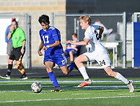 NWA Democrat-Gazette/CHARLIE KAIJO Rogers High School Brayan Flores (17) and Bentonville High School Andrew Brandenburg (24) cover a loose ball during a soccer game, Friday, April 26, 2019 at  Whitey Smith Stadium at Rogers High School in Rogers.