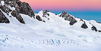Dawn over Fox Range with Big Mac 2,565m, Katies Col and Abel Janszoon Glacier in foreground on top of Fox Glacier NEVE, Westland Tai Poutini National Park, UNESCO World Heritage Area, West Coast, New Zealand, NZ