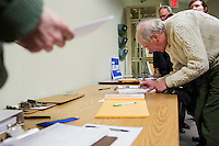 """Stephen Hall adds his signature to the ballot petition for Shenna Bellows, Democratic candidate in Maine for US Senate, at the Kittery Democrats town caucus in the Town Hall Council Chambers in Kittery, Maine, USA, on March 3, 2014. After listening to Bellows speak, Hall said he was """"very impressed"""" by the candidate and considers himself a supporter. Candidates must collect a certain number of valid citizen signatures to be included on the ballot. Bellows is trying to unseat incumbent Maine Republican Senator Susan Collins in the 2014 election. The town caucus had speeches from various other local candidates and also served to choose delegates for the 2014 Maine State Democratic Caucus."""