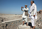 31 May 2013, 310513 Shikhano Village, Surkhrod District , Jalalabad, Afghanistan. Community Monitor program coordinator Janssagha Ahmad Zai,(left) and canal engineer Rahaim Alkozay visiting Surkhrod District irrigation canal sites. He is takeing picture with his mobile phone. Theses are sent back to Kabul where overseers of the projects  stay updated on progress and catch any problems. Canals are being built and rehabilitated under the Irrigation Restoration and Development Project (IRD). While some donors are supporting reconstruction/development of specific rivers the Emergency Irrigation Rehabilitation Project (EIRP) is instrumental in the Govt of Afghanistan's launch of a national irrigation scheme. Typical rehabilitation works would include improving canal intake structures, conveyance channels and aqua ducts. Picture by Graham Crouch/World Bank