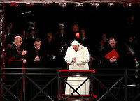 Papa Francesco celebra la Via Crucis al Colosseo, Roma, 18 aprile 2014. A sinistra, il cardinale vicario di Roma Agostino Vallini sorregge la croce.<br /> Pope Francis celebrates the Via Crucis (Way of the Cross) torchlight procession at the Colosseum, Rome, 18 April 2014. At left, Cardinal Agostino Vallini, Vicar General of Rome, holds the cross.<br /> UPDATE IMAGES PRESS/Isabella Bonotto<br /> <br /> STRICTLY ONLY FOR EDITORIAL USE