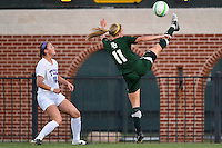 Baylor forward Natalie Huggins (11) attempts kick the ball back into the field during first half of an NCAA soccer game, Friday, October 03, 2014 in Waco, Tex. TCU draw 1-1 against Baylor in double overtime. (Mo Khursheed/TFV Media via AP Images)