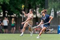 NEWTON, MA - MAY 22: Sydney Scales #45 of Boston College brings the ball forward as Andie Aldave #13 of Notre Dame defends during NCAA Division I Women's Lacrosse Tournament quarterfinal round game between Notre Dame and Boston College at Newton Campus Lacrosse Field on May 22, 2021 in Newton, Massachusetts.