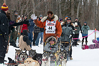 Brent Sass and team run past spectators on the bike/ski trail near University Lake with an Iditarider in the basket and a handler during the Anchorage, Alaska ceremonial start on Saturday, March 7 during the 2020 Iditarod race. Photo © 2020 by Ed Bennett/Bennett Images LLC