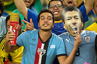 Uruguay fans wearing a Luis Suarez mask
