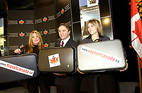 2001 File Photo<br /> Canadian Ministerof Industry ;<br />  Brian Tobin (M) pose with two unidentified women for the launch of  the Official Site of the Canadian Tourism Commission.in Montreal, CANADA.<br /> <br /> Photo by Sevy-IMAGES DISTRIBUTION <br /> <br /> NOTE :  D-1 H original JPEG, saved as Adobe 198 RGB