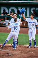 Rylan Bannon (18) of the Ogden Raptors meets team mates Donovan Casey (43) and Luis Paz (13) after hitting his first three run homer against the Great Falls Voyagers at Lindquist Field on September 14, 2017 in Ogden, Utah. The Raptors defeated the Voyagers 7-4 in Game One of the Pioneer League Championship. (Stephen Smith/Four Seam Images)