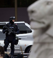 Glasgow, Scotland - A SWAT team extra standing next to the Lion in George Square during filming of  World War Z..Picture: Maurice McDonald/Universal News And Sport (Scotland). 24 August 2011. www.unpixs.com..