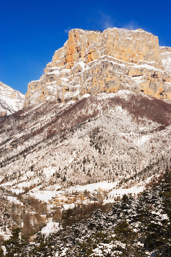 Village of Archiane sits in snow underneath the Rocher d?Archiane in the Cirque d?Archiane, Diois, Drome, Rhone-Alpes, France.