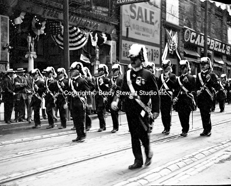 Pittsburgh PA:  Pittsburgh-area Manson marching in the annual St Patrick's Day Parade.  View of Officer and troop marching down 5th Avenue with crowds lining both sides of the street.