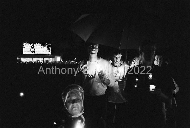 Memphis, Tennessee<br /> USA<br /> August 15, 2002<br /> <br /> A candle vigil of some 50,000 fans from around the world, gather outside of Graceland to mark the 25th anniversary of Elvis Presley's death. Here fans make their way to the grave of Elvis.