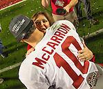 Alabama quarterback AJ McCarron hugs Terry Saban, wife of coach Nick Saban after the Crimson Tide defeated Notre Dame 42-14 to win the BCS National Championship football game at Sun Life Stadium in Miami on January 7, 2013. <br /> Credit: Mark Wallheiser for UPI Newsphotos ©2013 Mark Wallheiser