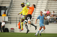Philadelphia forward, Danesha Adams (19) and Sky blue goalkeeper, Jenni Branam (23) collide in mid-air as they vie for the ball.  After a nearly two hour rain delay, Sky Blue FC defeated the Philadelphia Independence on a second half goal by Yael Averbuch in a game played at Yurcak Field on the Rutgers University Campus in Piscataway, NJ.