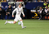 CARSON, CA - MARCH 07: Cristian Pavon #10 of the Los Angeles Galaxy moves with the ball during a game between Vancouver Whitecaps and Los Angeles Galaxy at Dignity Health Sports Park on March 07, 2020 in Carson, California.