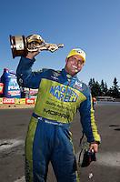 Aug. 4, 2013; Kent, WA, USA: NHRA funny car driver Matt Hagan celebrates after winning the Northwest Nationals at Pacific Raceways. Mandatory Credit: Mark J. Rebilas-USA TODAY Sports