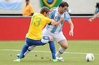 Argentina forward Gonzalo Higuain (9) goes against Brazil defender Bruno Uvini (13) The Argentina National Team defeated Brazil 4-3 at MetLife Stadium, Saturday July 9 , 2012.